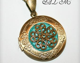 Locket necklace with Golden Flower and light blue background (p)