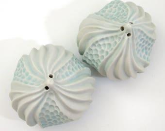 White & blue porcelain urchin salt and pepper shaker set