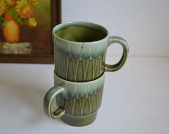 Pair of green retro coffee cups
