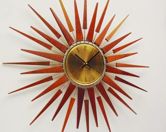 Starburst Clock by Seth Thomas, Mid Century Modern 1970s Starflower Sunburst Wall Clock. Dorm decor.  Professionally Refurbished.