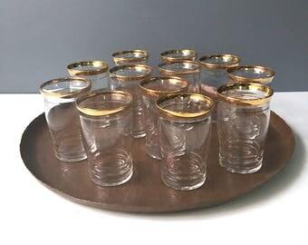 Flat juice or liqueur glasses with gold bands - set of 12 - vintage 1960s barware