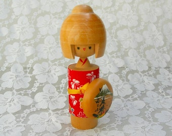 Adorable Japanese Kokeshi, contemporary wood doll, red chirimen (crepe) fabric, Mt. Fuji shield, kawaii girl