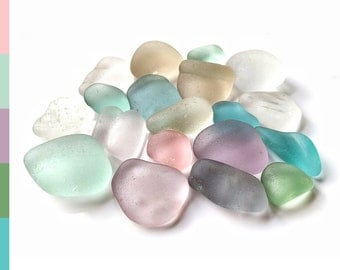 Frosted sea glass pieces in soft pastel colors, surf tumbled and washed up on a beach in Edinburgh 0815