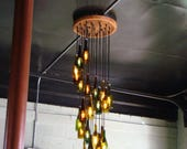 Stacy's custom wine bottle Chandelier hanging at 4 feet from the ceiling to the lowest bottle