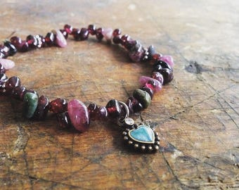 LIMITED Elastic stretch beaded bohemian bracelet with assorted burgandy and pink beads and turquoise color heart charm