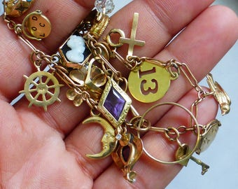 Heavy Solid Gold Antique FULL charm bracelet with extra bracelet Diamonds, amethyst, cameos and much more