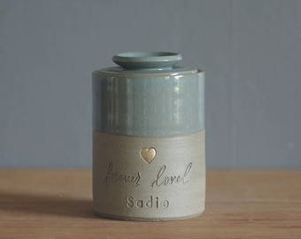 custom urn with ceramic lid. gold accent stamp shown, custom name and color. modern urn for ashes. satin turquoise on sand