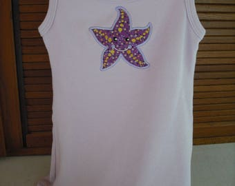 Baby girl knit dress with starfish. 100% cotton knit. Machine appliqued and embroidered. Size 2-3.