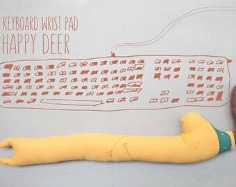 Keyboard wrist rest yellow moose.