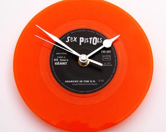 "The SEX PISTOLS Clock made from a recycled 7"" single, ""Anarchy in the UK"", Blue and Orange Coloured Colored vinyl Punk Rock Clock gift"