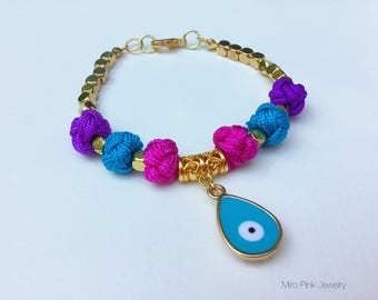 Turqoise evil eye charm bracelet with blue & purple chinese fabric knot beads