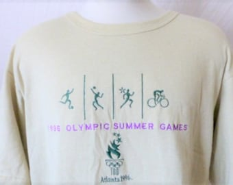 vintage 90's The 1996 Summer Olympic Games Atlanta beige light brown graphic t-shirt event souvenir embroidered purple teal logo oversize xl