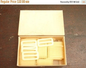 """ON SALE vintage 72 factory deadstock box of 2"""" white/clear belt buckles by permaloid, nyc"""