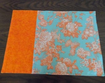 Set of 4 Reversible Pieced Placemats with Orange Flowers on a Soft Green Background with Cream Fabric on Reverse Side