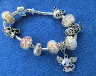 Snake chain bracelet with charms