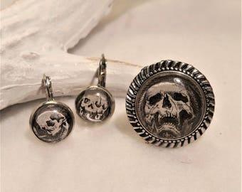 Memento Mori finery in silvery metal