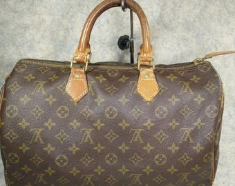 Authentic Louis Vuitton Vintage  Handbag Speedy 35 Monogram Canvas 1982 with lock no. 217 No Have Key, Canvas & Cowhide in Good Condition