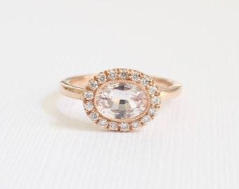 1.01 Ct. Oval Light Peach Sapphire Milgrain Bezel Halo Ring in 14K Rose Gold