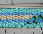 Aqua, blue and tan doormat handwoven from lobster trap rope