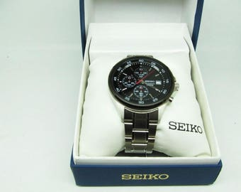 Men's Seiko 4T57 Chronograph new battery,box,papers and extra link near mint