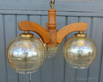 A three lamp, mid century, Wortmann and Filz, Mad Men style, Atomic vintage french, chandelier, pendant or ceiling light in wood and glass