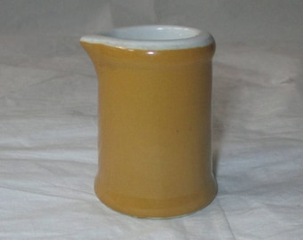 "Hall China Restaurantware 2.25"" Individual Creamer, Butterscotch & White (c. 1950s)"