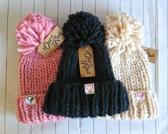 Oversized knitted hat with pompom and embroidered detail