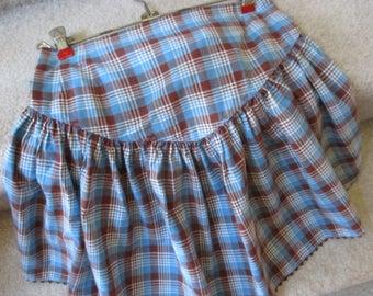 Vintage child's rickrack trimmed blue and brown plaid half apron  ruffled skirt