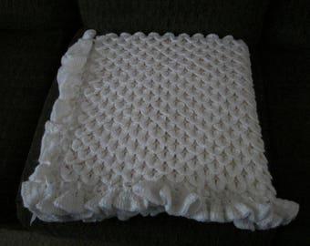 White baby blanket in crocodile stitch