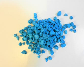 Bag of turquoise colour chips for jewellery making