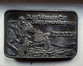 "Vintage Funny Belt Buckle - ""Any Woman Can Start Your Motor"""