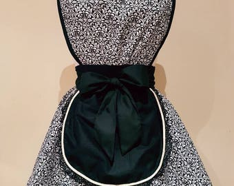 The 'Audrey Double Diner Apron' in Black Damask