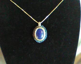 Seed bead bezeled lapis lazuli cabachon pendant