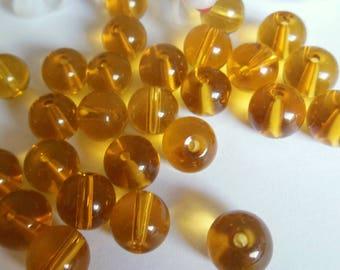 set of 10 round yellow glass beads