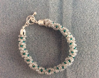 Kumihimo bracelet, clear and turquoise