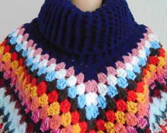 Bright cosy chunky poncho, crocheted in many colours and textures of up-cycled yarn