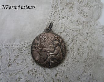 Antique fishing medal/pendant