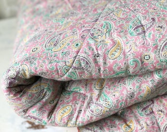 A beautiful 1930's pink paisley Comfy Durham quilt