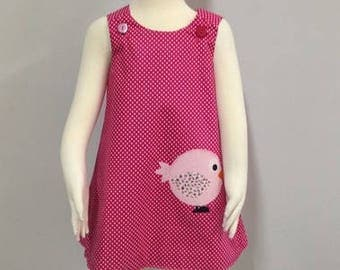 Girls reversible hot pink polkadot Birdy pinafore dress