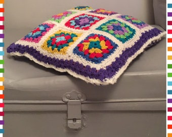 Rainbow granny square cushion