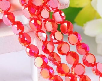 Faceted red glass, 6 mm diameter, sold in packs of 20 beads