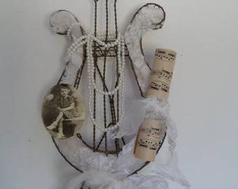 Twisted Metal lyre and shabby chic decoration