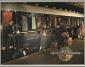 Venice Simplon: Orient Express (1982). Beautiful color illustrations of its polished wood, sumptuous upholstery & antique fixtures. (27931)