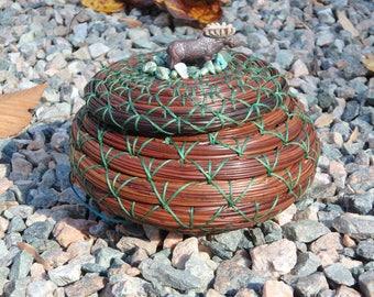 Moose bead lidded pine needle basket