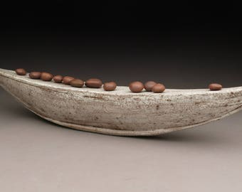 collaborative boat with stones