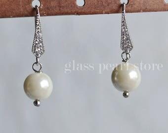 dangling pearl earrings,