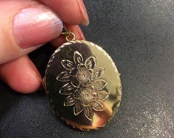 9ct gold locket ,oval,with engraved flowers