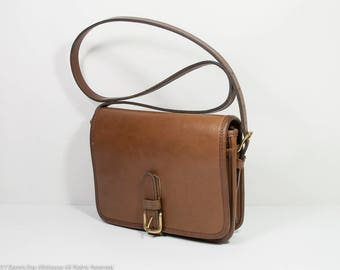 Vintage Coach NYC leather saddle pouch, Coach cross body buckle bag, Coach leather saddle bag in great condition, at Fresh Breeze Vintage