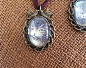 Beautiful cabochon necklace with vintage cat faces on organza Ribbon