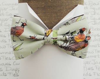 Bow ties for men, pheasant print  on a pale green cotton fabric